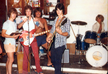 Practice in Jon's parents garage circa 1978 from left to right: Bill Priest, Jon Sheffield, Henry Marin, John Heaney, Steve Cascaddan